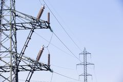 Electrical insulators on high voltage pylon Stock Photo