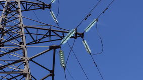Electrical insulators on high-voltage wires on a support close-up. power station. Renewable energy. Electricity. Transportation by wire stock footage