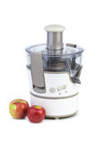 Electrical juicing machine and two apples Royalty Free Stock Photography