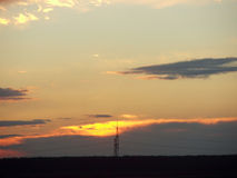 Electrical landscape in sunset 1. Electrical Pylon behind a sunset storm Royalty Free Stock Photos