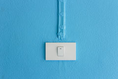 Electrical   light switch on blue wall. Stock Images