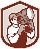 Electrical Lighting Technician Carry Spotlight Shield. Illustration of a electrical lighting technician crew carry fresnel spotlight on shoulder looking to side Royalty Free Stock Images
