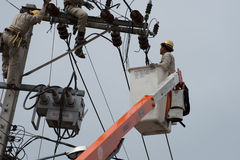 An electrical lineman working on a line Royalty Free Stock Photos