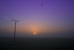 Electrical Mast in Sunrise Royalty Free Stock Photos