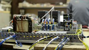 Electrical modules, switches, relays and cables are mounted on the circuit board. Control system of a modern CNC machine. Electrical modules, switches, relays stock video footage
