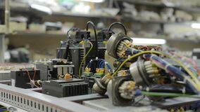 Electrical modules, switches, relays and cables are mounted on the circuit board. Control system of a modern CNC machine. Electrical modules, switches, relays stock video