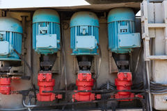 Electrical motors of an industrial equipment. Blue motors and re stock photos