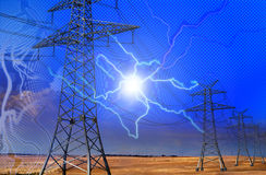 Electrical net. High voltage electric pillars being a part of a network, through fields Royalty Free Stock Photo