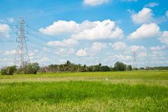 Electrical net of poles on blue sky Royalty Free Stock Photography