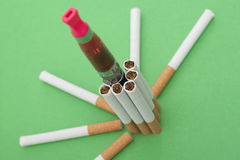 Electrical and ordinary cigarettes Royalty Free Stock Images