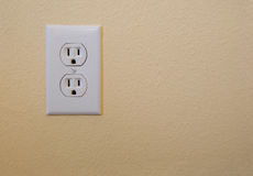 Electrical outlet. On a wall royalty free stock photos