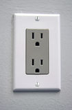 Electrical Outlet. A white electrical outlet with gray plate for US power Stock Photo