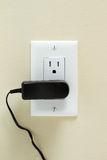 Electrical Outlet with cable. Electric cable in Electrical Outlet on the Wall. Power 110v royalty free stock photos