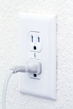 Electrical outlet with cord. On white wall stock images
