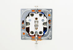 Electrical outlet during installation in office wall. Stock Image