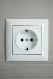 Electrical outlet installed on a gray background Stock Photos