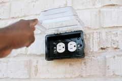 Electrical outlet outside with rain cover Stock Photography