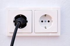 Electrical outlet with plug Stock Images
