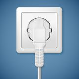 Electrical outlet with plug. Close-up power plug plugged in a socket Stock Images