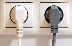 Electrical outlet and plugs. Electrical outlet with multiple plugs stock image