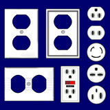 Electrical outlet plugs and faceplates in vector. Set of electrical outlet plugs and faceplates in vector with white plastic finish Stock Image