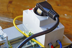 Electrical outlet with power plug installed on the DIN rail stock image