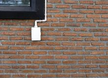 Power outlets on the brick wall vertical orientation. Electrical outlet on a red brick wall concept of power or connectivity,power outlets on the brick wall Stock Images