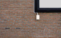 Power outlets on the brick wall vertical orientation. Electrical outlet on a red brick wall concept of power or connectivity,power outlets on the brick wall Stock Photos