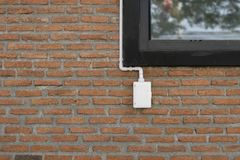 Power outlets on the brick wall vertical orientation. Electrical outlet on a red brick wall concept of power or connectivity,power outlets on the brick wall Stock Photo