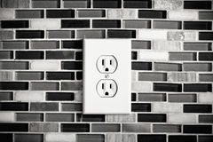 Electrical Outlet Set in a Modern Kitchen Backdrop. Black and White picture of an electrical outlet set in a modern kitchen background. Showing the surprised stock photography