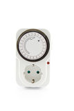 Electrical outlet timer. European electrical outlet timer with red light, isolated on white stock image