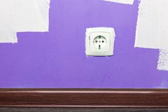 Electrical outlet on wall in room Royalty Free Stock Image