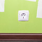 Electrical outlet on wall in room Stock Image