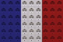 Electrical outlets in the colors of the French flag royalty free stock image