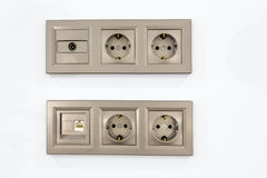 Electrical outlets input for TV and Internet. Four electrical outlets, input tv and internet on the white wall Stock Photo