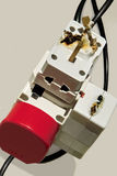 Electrical overload. Burned adapter, plugs. Electrical overload hazard. Burned adapter, plugs is on the gray background. The left side of picture is free for Stock Image