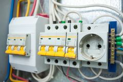 Electrical panel. Switches and socket in the electric shield Stock Photos