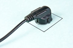 Electrical plug in drawn socket Stock Images