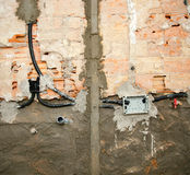 Electrical and plumbing installation in kitchen work Royalty Free Stock Images