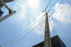 Electrical pole of city in sunny summer sky Royalty Free Stock Images