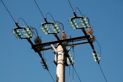 Electrical pole with insulator on blue sky Royalty Free Stock Photography