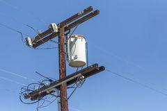 Electrical Pole with lines in a blue sky royalty free stock images