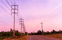 Electrical pole at sunset Stock Photos