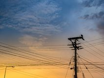 Electrical pole and sky in twilight time stock photo