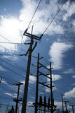 Electrical poles. Abstract silhouette of high voltage electrical pole structure, with blue sky Royalty Free Stock Photography
