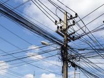 Electrical poles. High voltage power pole with wires tangled. Telegraph Pole Royalty Free Stock Photo