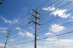 Electrical poles. Of high voltage in white cloud and blue sky Stock Photography