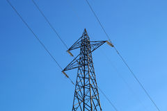Electrical poles of high voltage in white cloud and blue sky Stock Photos