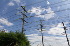Electrical poles. Machinery industry wire lantern pole mount sky Stock Images