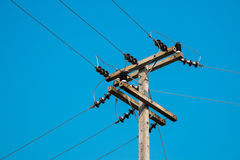 Electrical post by the local road with power line cables Royalty Free Stock Images